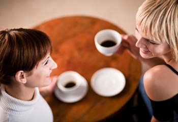 Two young women enjoying a coffee break